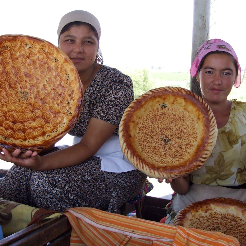 Uzbek women selling bread