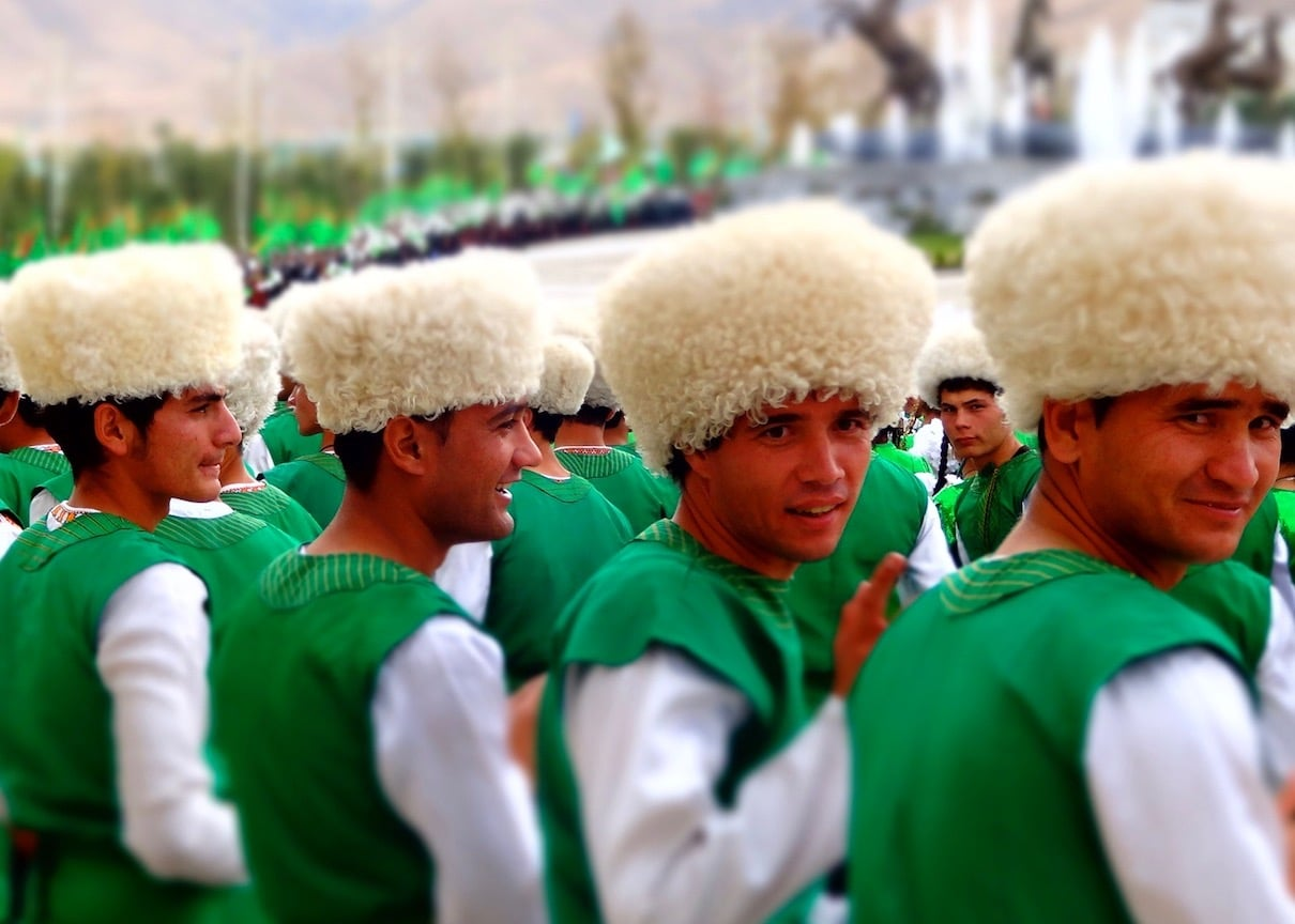 Turkmen men in traditional outfits