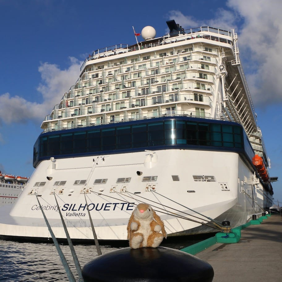 Bunny posing with her ship in the Bahamas