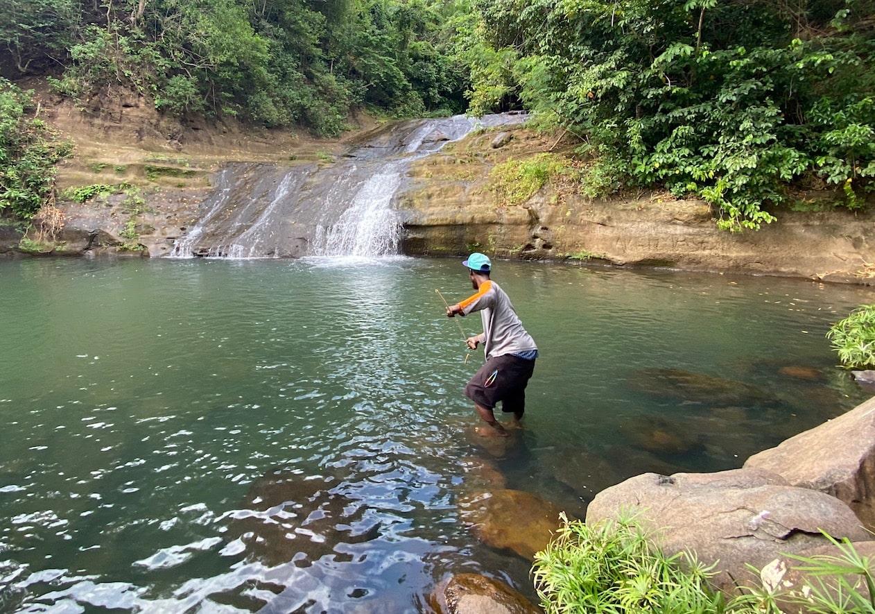 Local man fishing at Mt Carmel Falls