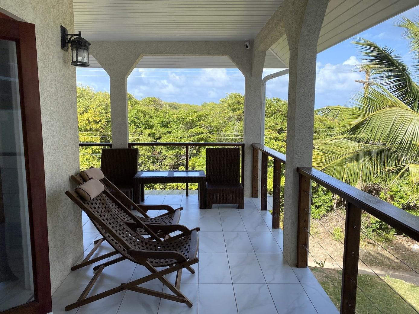 Wraparound porch with sea views